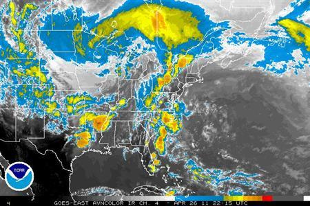 Storm systems are seen over the U.S. in an infrared satellite photo taken April 26, 2011. REUTERS/NOAA/Handout