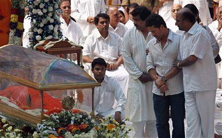 Indian cricketer Sachin Tendulkar (2nd R) pays his last respects to spiritual guru Sri Sathya Sai Baba at an ashram at Puttaparti in the southern Indian state of Andhra Pradesh April 25, 2011. Sai Baba, revered by millions of followers as a living god, died on Sunday in a hospital in southern India. He was 86. Sai Baba, who was admitted to hospital in his hometown of Puttaparti a month ago, died of multiple organ failure, media said. REUTERS/Adnan Abidi