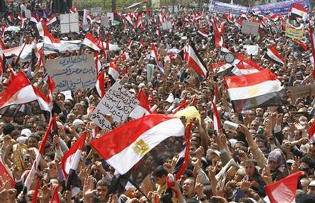 Protesters wave Egyptian flags during a protest in Tahrir square, Cairo, April 8, 2011. REUTERS/Mohamed Abd El-Ghany