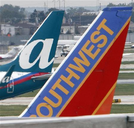 AirTran and Southwest Airlines jets sit on the tarmack at Midway International airport in Chicago September 27, 2010. REUTERS/Frank Polich