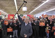 <p>Canada's NDP leader Jack Layton raises his cane at a campaign rally in Winnipeg, Manitoba April 27, 2011. Canadians will head to the polls in a federal election on May 2. REUTERS/Fred Greenslade</p>