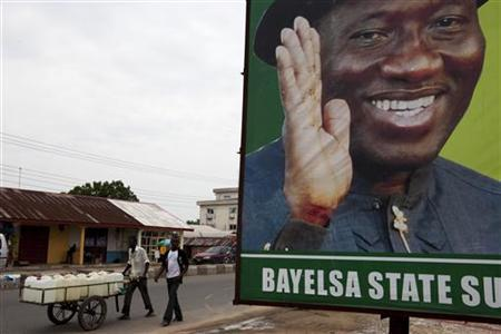 A signboard of Nigerian President Goodluck Jonathan is seen along a road in Yenegoa, Bayelsa state capital April 18, 2011. REUTERS/Joseph Penney