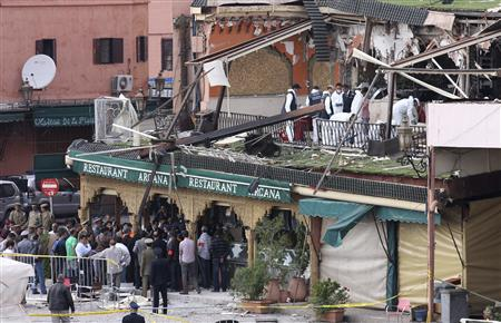 Investigators work at the scene of an explosion which rocked the Argana cafe in Marrakesh's Jamaa el-Fnaa square April 28, 2011. REUTERS/Youssef Boudlal