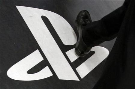 A man walks on a floor advertisement for Sony Corp's PlayStation 3 game console at an electronic store in Tokyo April 27, 2011. REUTERS/Yuriko Nakao