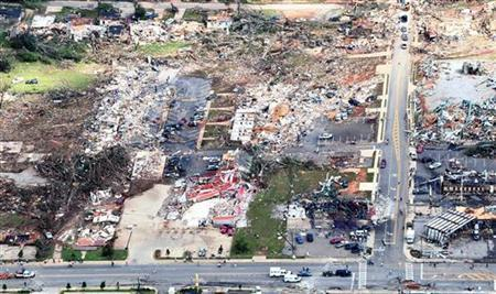 An aerial view shows extensive damage to homes and businesses in the path of tornadoes in Tuscaloosa, Alabama, April 28, 2011. REUTERS/Marvin Gentry