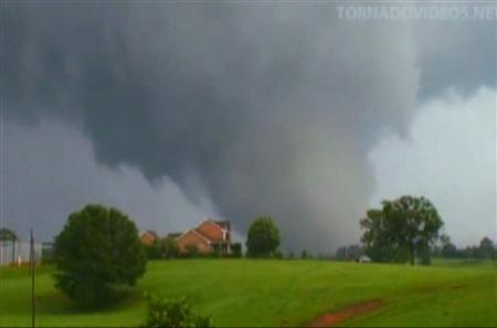 A tornado is pictured moving through Scooba, Mississippi, in this still image taken from video on April 27, 2011 and released on April 28. Tornadoes and violent storms ripped through seven Southern states, killing at least 295 people and causing billions of dollars of damage in some of the deadliest twisters in U.S. History. Mandatory Credit REUTERS/Image Courtesy of TornadoVideos.net/Discovery/Handout