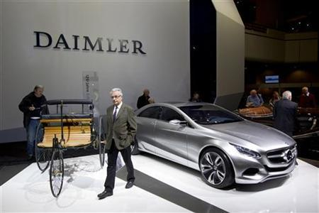 Historical and future Daimler cars are on display at a Daimler annual shareholder meeting in Berlin, April 13, 2011. REUTERS/Thomas Peter