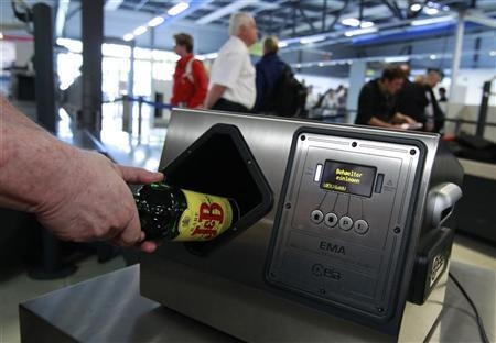 Airport staff demonstrates a liquid scanner at Schoenefeld airport outside Berlin, April 27, 2011. REUTERS/Thomas Peter