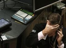 <p>A trader works on the floor of the New York Stock Exchange, October 14, 2009. REUTERS/Brendan McDermid</p>