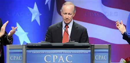 Indiana Governor Mitch Daniels is applauded as he takes to the lectern at the Conservative Political Action conference (CPAC) dinner in Washington February 11, 2011. REUTERS/Jonathan Ernst
