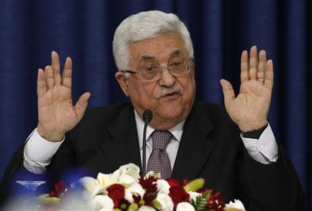 Palestinian President Mahmoud Abbas gestures as he speaks during a news conference after a meeting with members of the Israeli Peace Initiative in the West Bank city of Ramallah April 28, 2011. REUTERS/Mohamad Torokman
