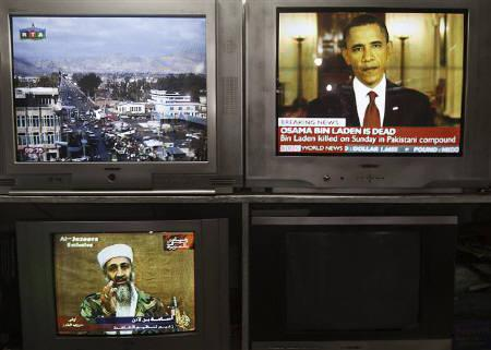 News telecasts are broadcasted on television sets at a store in Kabul May 2, 2011. REUTERS/Ahmad Masood