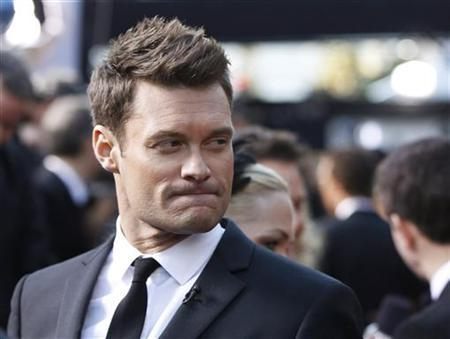 Radio and television personality Ryan Seacrest arrives at the 83rd Academy Awards in Hollywood, California February 27, 2011. REUTERS/Lucas Jackson