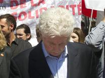 <p>Bloc Quebecois leader Gilles Duceppe walks in the May Day parade during a campaign stop in Montreal, May 1, 2011. REUTERS/Christinne Muschi</p>