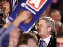 <p>Conservative Party leader and Prime Minister Stephen Harper greets supporters at his federal election night headquarters in Calgary, Alberta, May 2, 2011. REUTERS/Chris Wattie</p>