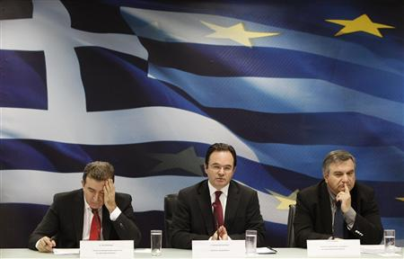 Greece's Development Minister Mihalis Chrysohoidis (L), Finance Minister George Papaconstantinou (C) and Infrastructure Minister Harris Kastanidis attend a news conference in Athens May 2, 2011. REUTERS/John Kolesidis