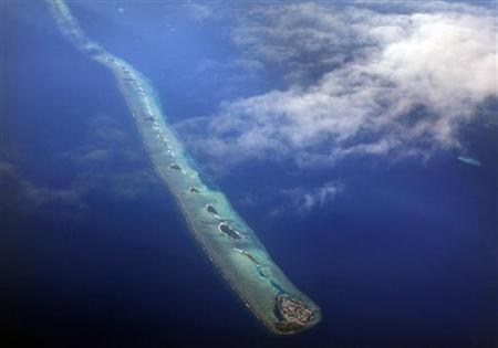 An aerial view shows an atoll in the Maldives, December 9, 2009. REUTERS/Reinhard Krause