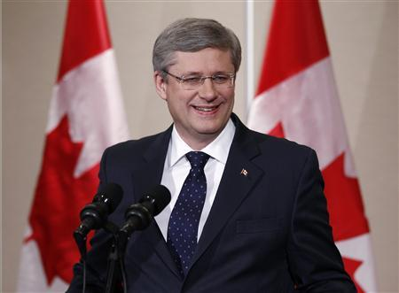 Conservative leader and Canada's Prime Minister Stephen Harper smiles during a news conference in Calgary, Alberta May 3, 2011. REUTERS/Chris Wattie