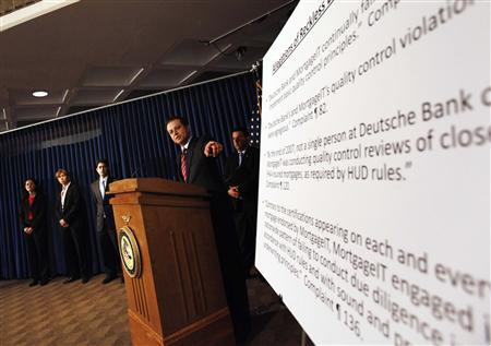 Preet Bharara, the United States Attorney for the Southern District of New York, points to a chart during a news conference in New York, May 3, 2011. REUTERS/Shannon Stapleton