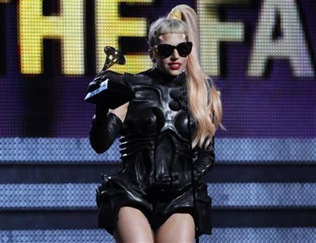 Lady Gaga accepts her award for Best Pop Vocal Album for ''The Fame Monster'' at the 53rd annual Grammy Awards in Los Angeles, California, February 13, 2011. REUTERS/Lucy Nicholson