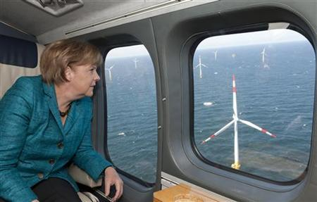 German Chancellor Angela Merkel flies in a helicopter over the Offshore Windpark Baltic 1 near the Baltic sea Peninsula of Zingst, May 2, 2011. REUTERS/Bundesregierung/ Guido Bergmann/Pool