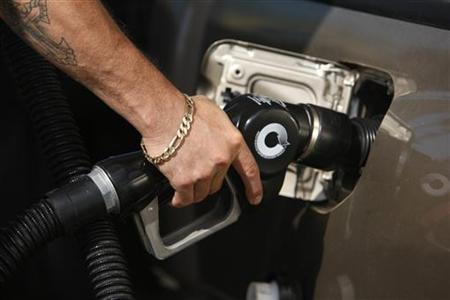 A man fills up his truck with gas at a gas station in Santa Monica, California, in this May 28, 2008 file photo. REUTERS/Lucy Nicholson/Files