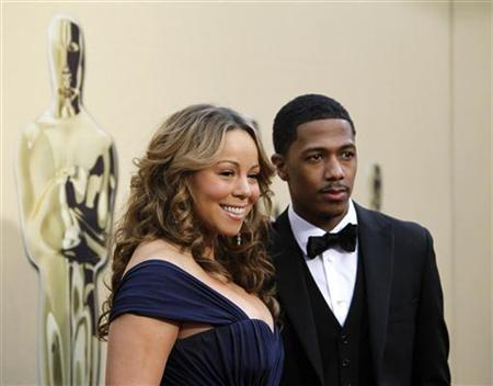 Singer Mariah Carey and husband Nick Cannon arrive at the 82nd Academy Awards in Hollywood March 7, 2010. REUTERS/Mario Anzuoni