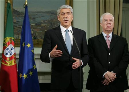 Portuguese Prime Minister Jose Socrates (L) makes a statement next to Finance Minister Fernando Teixeira dos Santos at the Sao Bento palace in Lisbon May 3, 2011. REUTERS/Government Handout