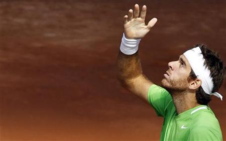 Juan Martin del Potro of Argentina looks up to the sky as he celebrates his victory over Marin Cilic of Croatia during their Madrid Open tennis match May 4, 2011. REUTERS/Susana Vera