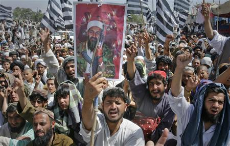 Supporters of Pakistani religious party Jamiat-e-ulema-e-Islam hold an image of al-Qaeda leader Osama bin Laden as they shout anti-U.S. slogans, during a rally on the outskirts Quetta May 6, 2011. About 1,500 Pakistani Islamists protested on Friday against the killing of bin Laden, saying more figures like him would arise to wage holy war against the United States. REUTERS/Naseer Ahmed