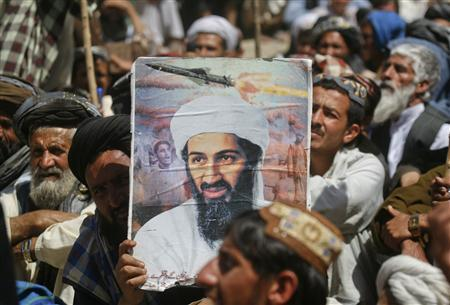 A supporter of the Pakistani religious party Jamiat-e-ulema-e-Islam holds an image of Osama bin Laden during an anti-U.S. rally on the outskirts of Quetta, May 6, 2011. REUTERS/Naseer Ahmed