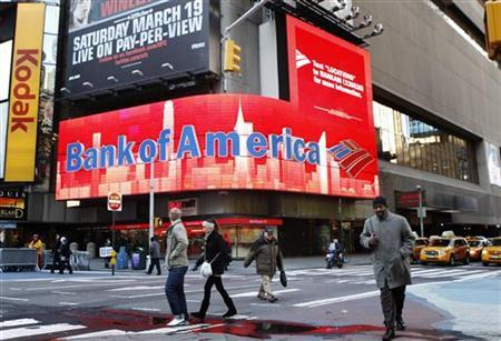 Pedestrians walk past a Bank of America sign on a building in Times Square in New York March 8, 2011. REUTERS/Lucas Jackson