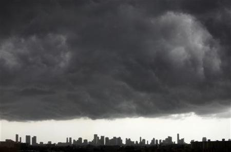 Dark clouds pass over downtown Miami, Florida August 15, 2010. REUTERS/Carlos Barria