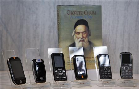 Kosher cellular phones, imported and distributed by Israeli Accel Telecom, are displayed at the company's offices in Tel Aviv May 2, 2011. REUTERS/Nir Elias