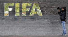 <p>A cameraman films in front of the main entrance of the Home of FIFA in Zurich October 20, 2010.REUTERS/Christian Hartmann</p>