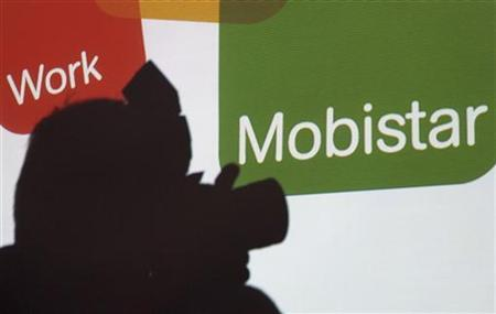 The shadow of a photographer is seen on Belgium's second biggest mobile phone operator Mobistar's company logo during a news conference aimed at presenting its 2007 results in Brussels February 5, 2008. REUTERS/Sebastien Pirlet