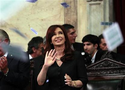Argentina's President Cristina Fernandez de Kirchner waves as she enters Congress for the inauguration of the annual ordinary session in Buenos Aires, in this March 1, 2011 file photo. REUTERS/Marcos Brindicci/Files