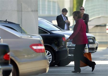 German Chancellor Angela Merkel enters the Chancellery in Berlin, May 9, 2011. REUTERS/Thomas Peter