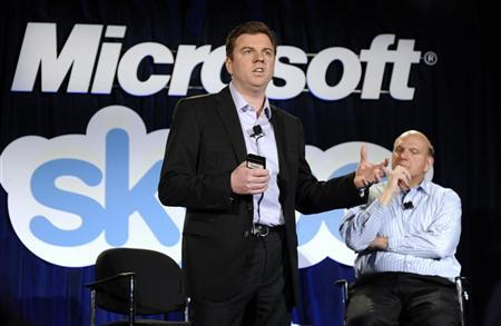 Skype Chief Executive Officer Tony Bates (L) speaks as Microsoft CEO Steve Ballmer listens at their joint news conference in San Francisco, May 10, 2011. Microsoft and Skype announced Tuesday that they have entered a definitive agreement under which Microsoft will acquire Skype for $8.5 billion from the investor group led by Silver Lake. REUTERS/Susana Bates
