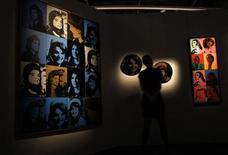 <p>A presenter stands beside Andy Warhol's Sixteen Jackies (L) at an exhibition hall displaying highlights from the New York Sales of impressionist, modern and contemporary art, ahead of Sotheby's Spring Sales in Hong Kong March 31, 2011. REUTERS/Bobby Yip</p>