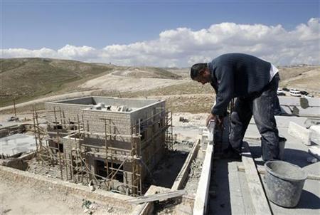 A Palestinian labourer works on a construction site in the West Bank Jewish settlement of Kedar, near Jerusalem March 13, 2011. REUTERS/Ammar Awad