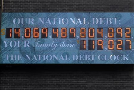The National Debt Clock hangs from a building near Times Square in New York February 14, 2011. REUTERS/Joshua Lott