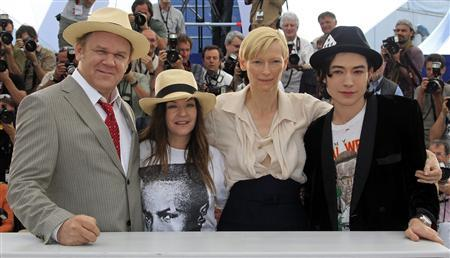 Director Lynne Ramsay (2nd L) and cast members (L to R) John C. Reilly, Tilda Swinton, and Ezra Miller pose during a photocall for the film ''We Need To Talk About Kevin'', in competition at the Cannes Film Festival, May 12, 2011. REUTERS/Yves Herman