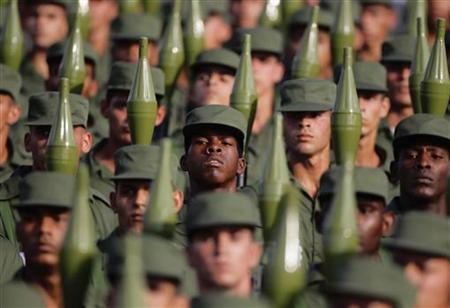Cuban soldiers carry rocket propelled grenade launchers during a military parade in Havana's Revolution Square April 16, 2011. REUTERS/Desmond Boylan