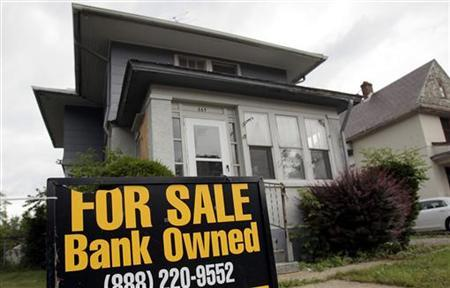 A ''For Sale- Bank Owned'' sign sits in front of a home in Pontiac, Michigan June 19, 2009. REUTERS/Rebecca Cook