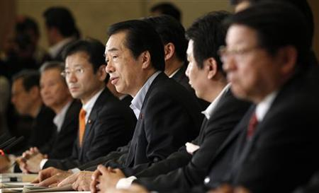 Japan's Prime Minister Naoto Kan (C) speaks during a cabinet ministers' meeting to discuss crippled nuclear power plant operator Tokyo Electric Power Company's (TEPCO) compensation plan in Tokyo May 12, 2011. REUTERS/Kim Kyung-Hoon