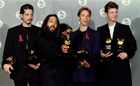 Members of the group 'Soundgarden' pose with the Grammy Award they received for Best Metal Performance for ''Spoonman'' at the 37th Annual Grammy Awards March 1 in Los Angeles. Reuters/handout