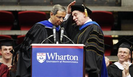 Citigroup CEO Vikram Pandit (L) is introduced by Wharton School Dean Thomas S. Robertson (R) before speaking to the University of Pennsylvania's Wharton School MBA graduates at the Palestra, on the campus of the University of Pennsylvania, in Philadelphia, May 15, 2011. REUTERS/Tim Shaffer