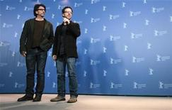 <p>Directors Joel (L) and Ethan Coen pose during a photocall to promote the movie 'True Grit' at the 61st Berlinale International Film Festival in Berlin February 10, 2011. The Berlinale International Film Festival runs from February 10 to 20, 2011. REUTERS/Christian Charisius</p>