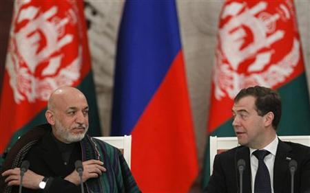 Russian President Dmitry Medvedev (R) and his Afghan counterpart Hamid Karzai attend a news conference after their meeting in Moscow, January 21, 2011. REUTERS/Denis Sinyakov